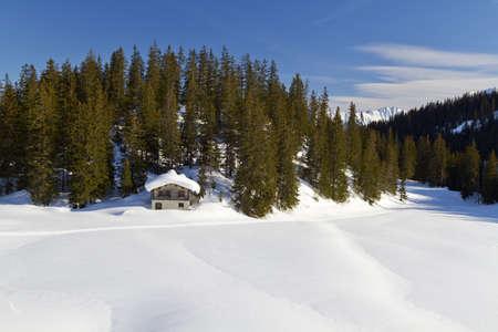 Log cabin in snow in the Alps Stock Photo