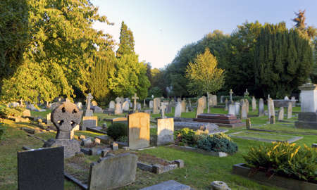 Graveyard at sunset in England Editorial