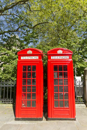Freshly painted London Red Phone Boxes