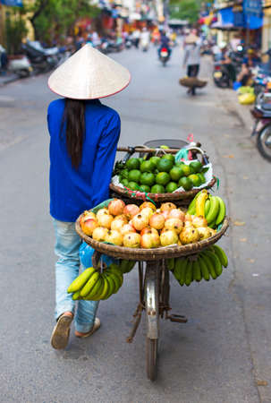 Typical street vendor in Hanoi, Vietnam photo