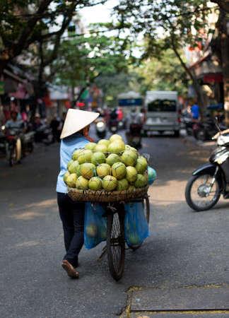 vendor: A Typical Street Vendor in Hanoi Vietnam