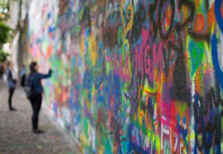 PRAGUE, CZECH REPUBLIC - June 19,2015: The Lennon Wall in Prague filled with John Lennon-inspired graffiti Editorial