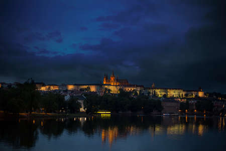 View of the Charles Bridge and Castle in Prague at night.