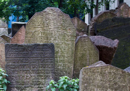 PRAGUE, CZECH REPUBLIC - June 19, 2015: Abandoned tombstones at the Old Jewish Cemetery in Prague, Czech Republic. Editorial