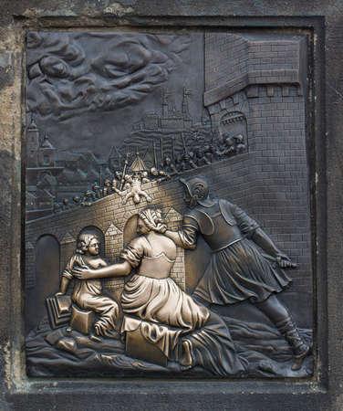 Brass relief of St. John of Nepomuk on Charles Bridge in Prague