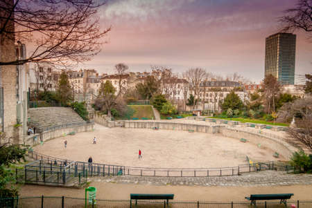 Winter in Paris inside the beautiful Latin Quarter and its Arenes de Lutece is nice when children play football when some century before, gladiators were fighting till death ! Stock Photo