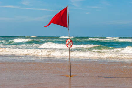Red flag in ocean, Lacanau, France Stock Photo