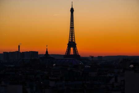 Eiffel tower at sunset from Haussmann Rooftop