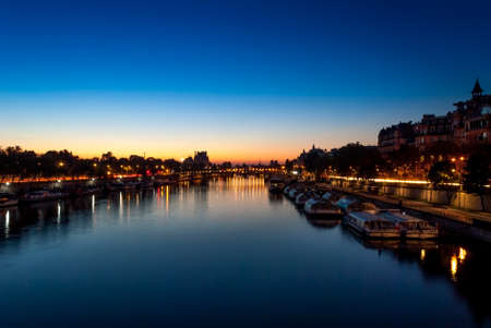 Seine River view on the Louvre at sunrise, Paris, France Stock Photo