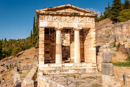 delfi: Athenian Treasury in Delphi, an archaeological site in Greece, at the Mount Parnassus. Stock Photo