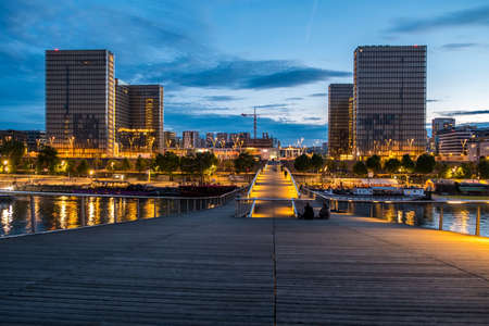 The french national library (BNF Francois Mitterand) by night from the passerelle Simone de Beauvoir Editorial