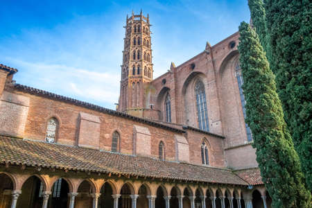 Cloisters and Courtyard Garden of Dominican monastery Couvent des Jacobins on a sunny day in Toulouse, France