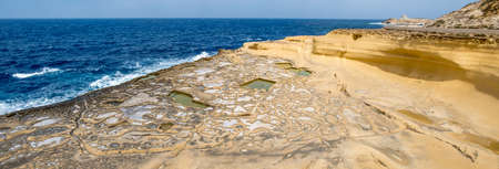 Panorama of Salt evaporation ponds, also called salterns or salt pans located near Qbajjar on the maltese Island of Gozo.
