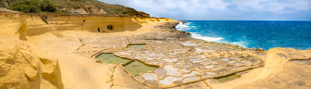Panoramic view of Salt evaporation ponds, also called salterns or salt pans located near Qbajjar on the maltese Island of Gozo.