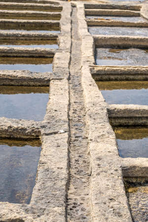 Salt pans located near Qbajjar on the maltese Island of Gozo. Close view