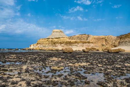 Sandstone butte of Salt Pans, Xwejni Bay, Xwejni, Gozo Island, Malta, Europe
