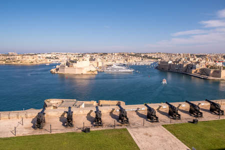 Panorama of the Maltese capital city Valletta. The Saluting Battery of La Valletta and Fort St. Angelo of La Vittoriosa in Malta