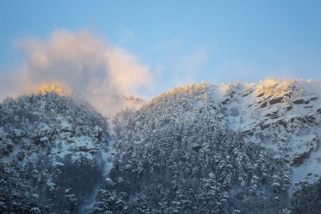 Snow mountains at sunset with fog photo