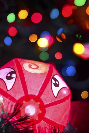 Red paper fish at boke background xmas photo