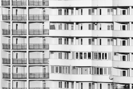 Black and white building windows fill all frame Stock Photo