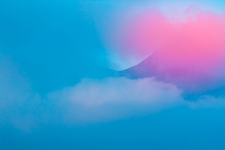 Mountain in clouds landscape blue and pink sunset colours photo