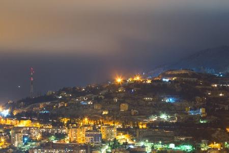 nishinomiya: Night mountain city light in fog landscape