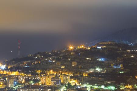 City under mountain at night landscape photo