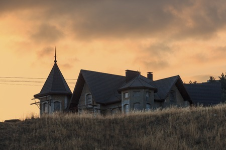Unfinished building on the hill at sunset landscape photo