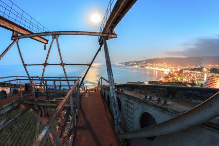 Metal construction of cableway at night city landscape photo