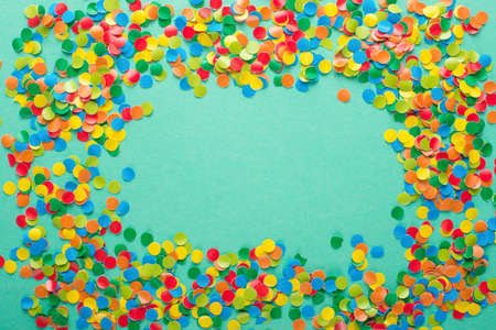 Colorful Confetti in front of blue Background. Stock Photo
