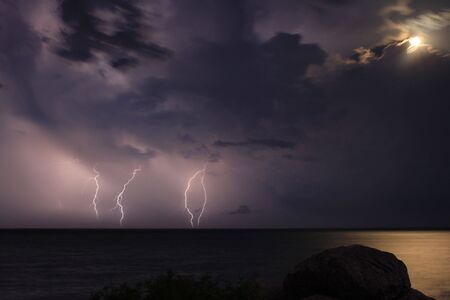 The storm over the ocean. Moonlight. Stock Photo - 8231477