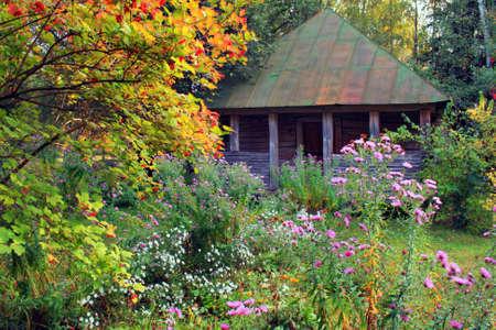 Little House in the autumn garden photo