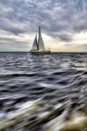 Yacht at sea photo