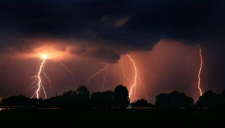 Thunderstorm in the field. Triple blow Stock Photo