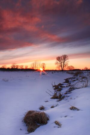 Colorful sunset over frozen lake photo