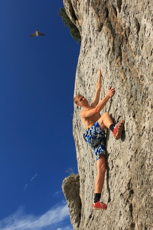 Rock climber on a cliff Stock Photo - 8920362
