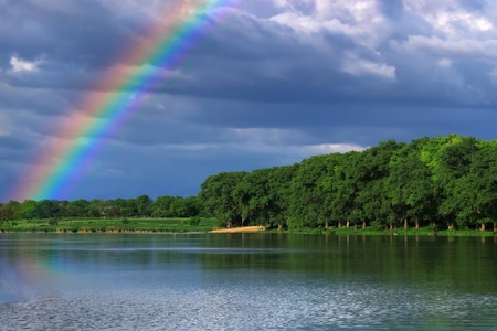 early morning: Rainbow over the lake close up Stock Photo