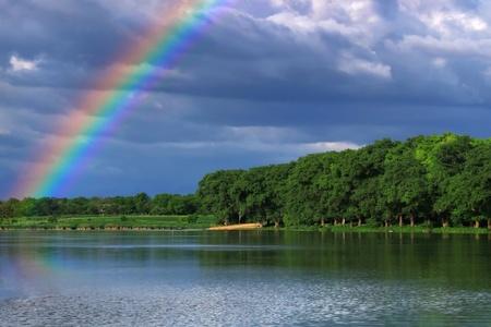 Rainbow over the lake close up Standard-Bild
