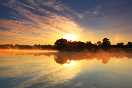 Reflection of the dawn sky in a lake Stock Photo