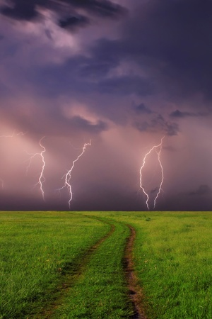 Thunderstorm at the spring field photo