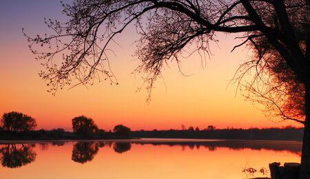 Quiet spring sunrise over the lake
