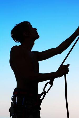Silhouette insuring climber photo
