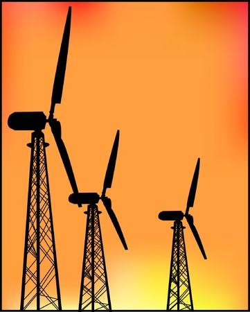 Windmills power at sunset