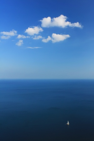 Yacht in ocean under blue sky photo