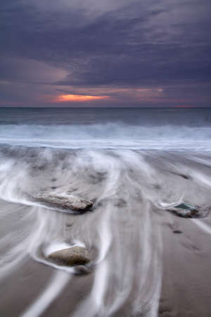 Stormy sunset on the sea photo