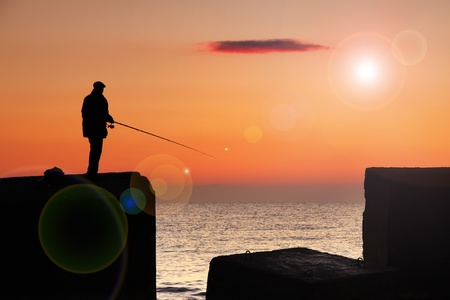 Fisherman at sunrise on the sea Stock Photo - 12082922