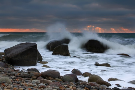 Stormy dawn on the sea photo