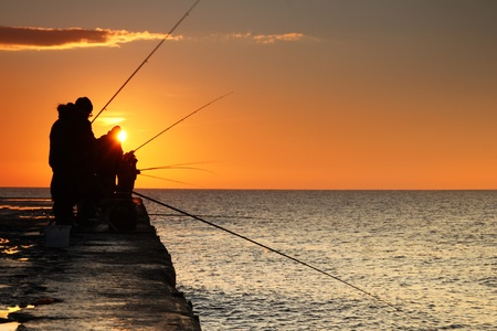 Fishermen at sunrise on the sea Stock Photo - 12313639