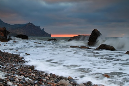 Stormy sunrise on the sea photo