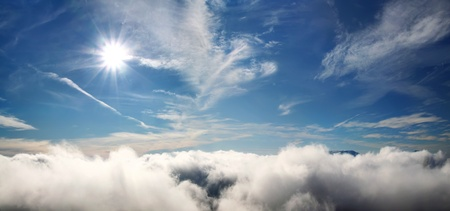 cirrus: Clouds with the sun under tropical sea Stock Photo